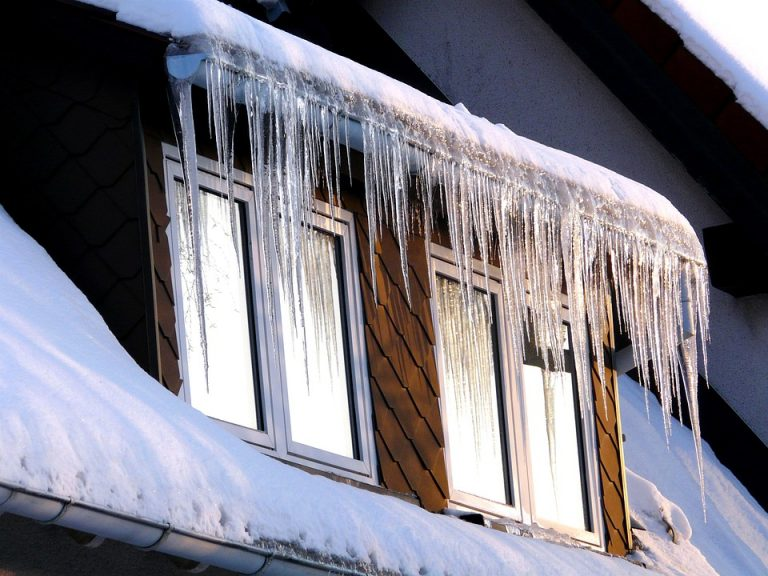 The Dangers of Letting Snow Build Up on Your Roof